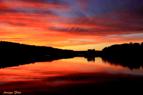 sunset water reflection resevoir lake sky cloudsstormssunrisessunsets clouds nature landscape scenery scenic calm weatherphotography