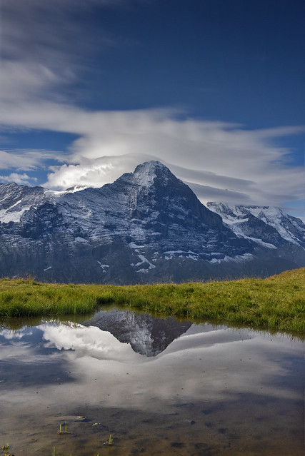 The Mighty  Eiger reflected in a puddle . Trift, Grindelwald. Canton of Bern. Switzerland.  Izakigur No. 3041. 27.08.18, 09:59:15