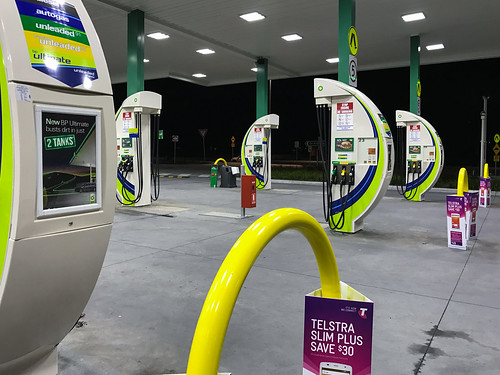 moorooduc victoria australia au petrol station bp pumps baxter auspctaggedpc3911 pc3911 curves lines shapes purple yelow green 2 tanks 2tanks telstra ultimate signs sign visualoverload advertising trove australiainpictures troveaus unfound art servo petrolstation