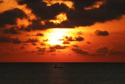 boat fishingboat beautifulsunset sunlight warmsunset sunshine redsunset sunset clouds cloudy cloud orange red man silhouette tanjungaru shangrilatanjungaru kotakinabalu sabah borneo malaysia asia southeastasia east fareast southchinasea pacific pacificocean ocean wet water