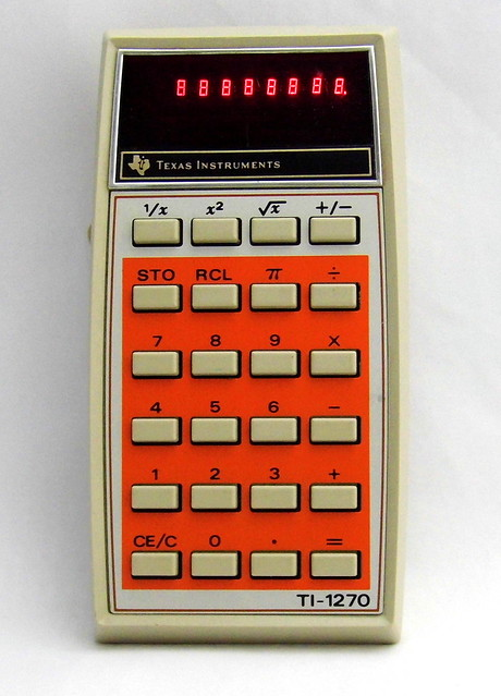 Vintage Texas Instruments Electronic Pocket Calculator (Powered On), Model TI-1270, Red LED Display, Made in USA, Circa 1976