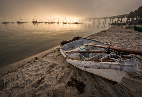 california san diego sandiego coronado bridge sunrise sunset beach photography mikeoria mikeoriaphotography pentax k3ii sigma 816 8mm gps dinghy boat rowboat oars sun light sand sailboat corobadobridge tidelands park landscape seascape