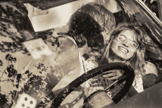 man advances on woman in a car