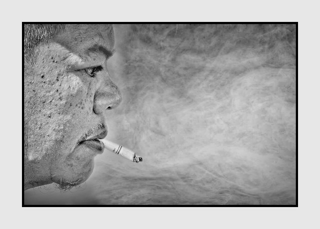 Man in Profile Smoking