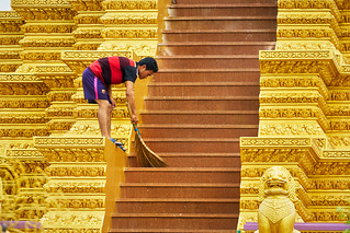 Man sweeping steps of Temple in Phnom Penh Cambodia | by BryonLippincott