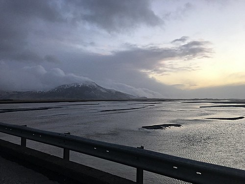 iceland landscape nature beauty mountains sunrise skies roads winter cold ringroad mountain ocean sea bay freshwater watershed ice rail railguard water sky sunset