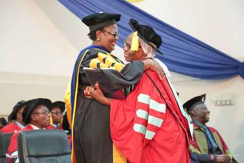 A graduand being congratulated by Prof. Dora F. Edu-Buandoh, Provost, College of Humanities and Legal Studies