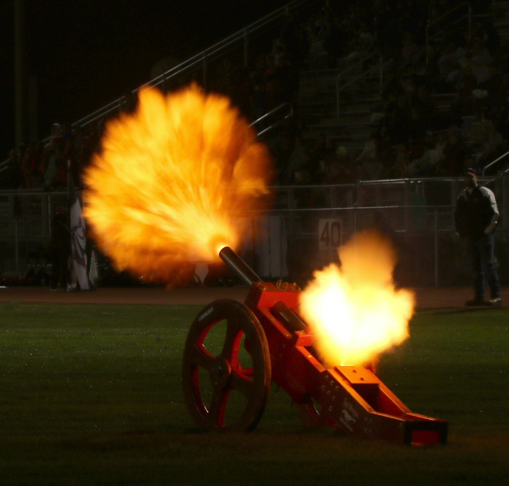 Cannon firing after a Fort Morgan Mustangs score in their
