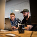 First Lt. Justin Hohman, Engineering Practice lead, and Adam Furtado, Chief Product Officer, work together May 30, 2018 to craft software code at Kessel Run, a program within the Defense Innovation Unit Experimental, a United States Department of Defense organization in Boston. Air Force software coders have been learning new and innovative techniques, such as coding in pairs to enable context sharing across the team, to deliver software solutions to the warfighter in weeks and months instead of years. (U.S. Air Force photo by J.M. Eddins Jr.)