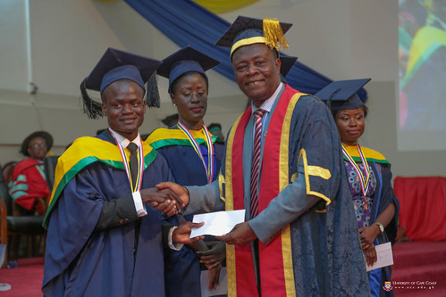 Prof. George K. T. Oduro, Pro-Vice-Chancellor of the University of Cape Coast, presenting an award to a graduand.