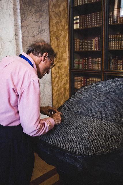 Studying the Rosetta stone, London, England
