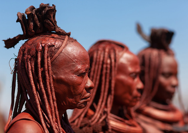 Himba tribe women covered with otjize, Cunene Province, Oncocua, Angola
