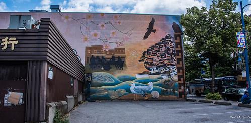 2018 bc britishcolumbia canada cropped nikon nikond750 nikonfx tedmcgrath tedsphotos vancouver vancouverbc vancouvercity vignetting ritabuchwitzjoeymallett ritabuchwitzjoeymallettmural ritabuchwitzjoeymallettmuralvancouver ritabuchwitz ritabuchwitzmural ritabuchwitzmuralvancouver joeymallett joeymallettmuralvancouver joeymallettvancouver mural wallmural streetscene street hoponhopoff hoponhopoffvancouver chinatown chinatownvancouver celebratingcommunity celebratingcommunitymural celebratingcommunitymuralvancouver downtowneastside downtowneastsidevancouver vancouverchinatown dtes dtesvancouver parkinglot bus tourbust touristbus birds seagulls parkingmeter parkingmetre trees cans2s
