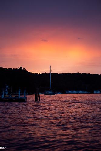 sunset sailboat lake winnipesaukee