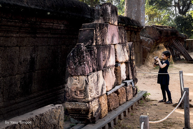 View of a Young Photographer Shooting Blocks of Artwork that Need to be Assembled as Part of Banteay Srei Temple, Angkor, Cambodia-18