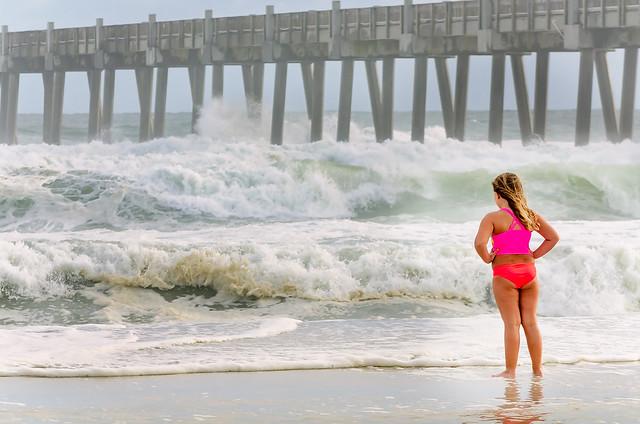 Girl stares at crashing surf on Pensacola Beach before Hurricane Michael