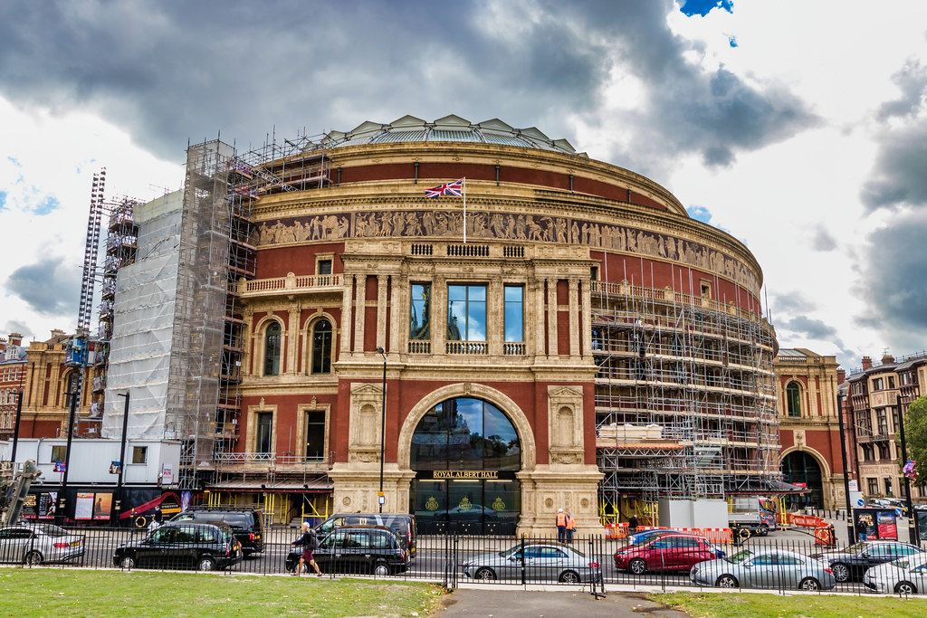 The Royal Albert Hall is a concert hall on the northern edge of South Kensington, London, which has held the Proms concerts annually each summer since 1941. It has a capacity of up to 5,272 seats. The Hall is a registered charity held in trust for the nation and receives no public or government funding.  Since its opening by Queen Victoria in 1871, the world's leading artists from many performance genres have appeared on its stage and it has become one of the UK's most treasured and distinctive buildings. The location of some of the most notable events in British culture, each year it hosts more than 390 shows in the main auditorium, including classical, rock and pop concerts, ballet, opera, film screenings with live orchestra, sports, award ceremonies, school and community events, charity performances and banquets. A further 400 events are held each year in the non-auditorium spaces.   The Hall was originally supposed to have been called the Central Hall of Arts and Sciences, but the name was changed to the Royal Albert Hall of Arts and Sciences by Queen Victoria upon laying the Hall's foundation stone in 1867, in memory of her husband, Prince Albert, who had died six years earlier. It forms the practical part of a memorial to the Prince Consort – the decorative part is the Albert Memorial directly to the north in Kensington Gardens, now separated from the Hall by Kensington Gore.  Thanks: Wiki