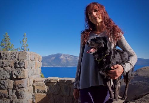 dog companions hiking scenic overlook view lake