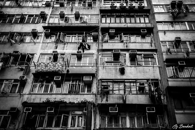 Behind grey walls