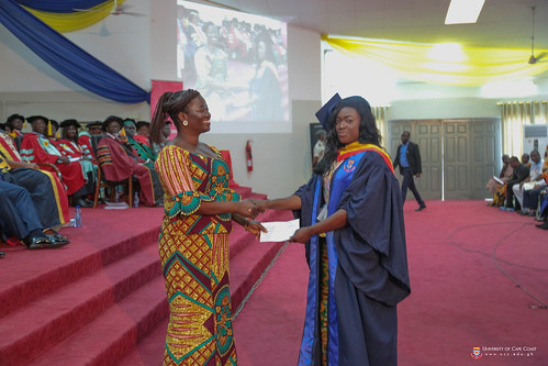 Mrs. Elizabeth Obese, Director of Finance, University of Cape Coast, presenting an award to an outstanding student.
