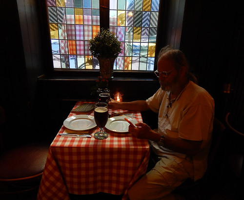 Stained-glass window and checkered tablecloths in Café Sorgenfri in Copenhagen, Denmark