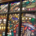 Stained glass artwork in the library. State Librarian Beverly Cain, Julia Ward, and Bill Morris traveled to Northwest Ohio in August 2018  to meet former State Library Board Member, John Myles, for a tour of four public libraries and the Museum of Fulton County.