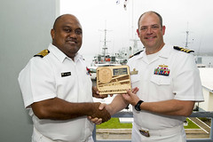 Cmdr. Andy Strickland, commanding officer USS Shoup (DDG 86), exchanges gifts with Capt. Humphrey Tawake, commander of the Fiji Navy, Oct. 15. (U.S. Navy/MC2 William Collins III)