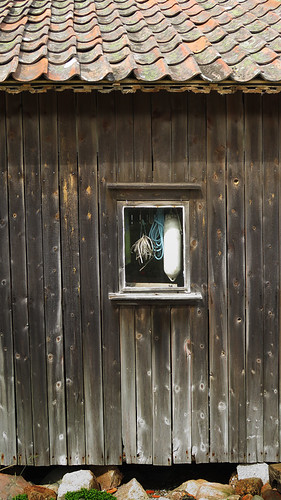 A window in a wooden boathouse in Gronemad, Sweden