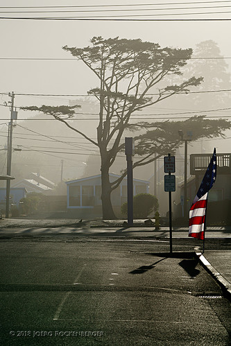 city flag fog foggy mist oregon railroad road rockawaybeach streetphotography sunrise usa