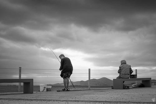 fisherwoman greece clouds piraeus bw bythesea fishing dramaticsky