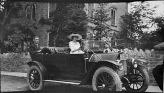 Automobile driver and passenger in front of Mr. D. Gillies' residence, Carleton Place, Ontario / Une conductrice et un passager dans une automobile devant la résidence de M. D. Gillies, Carleton Place (Ontario)
