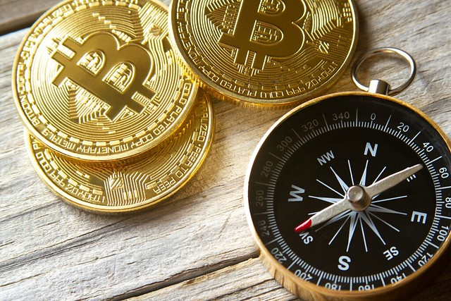 Bitcoins with navigational compass