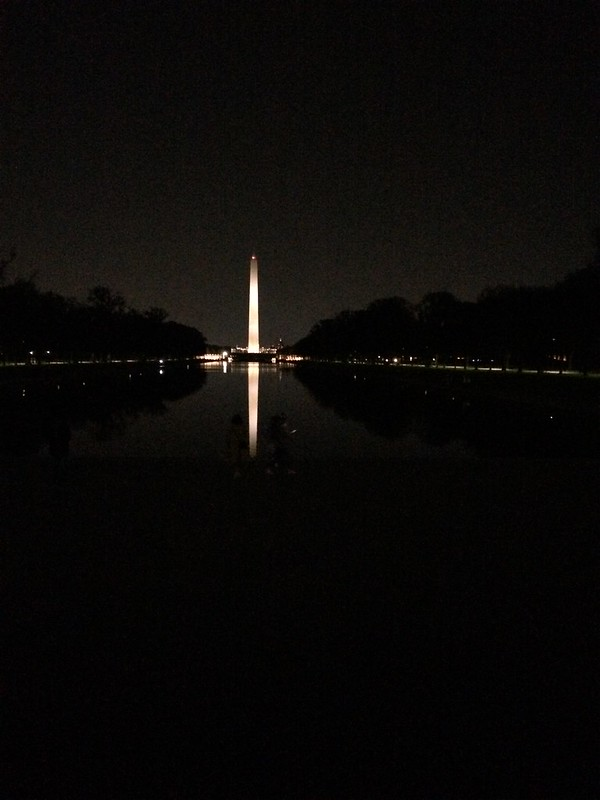 Electric scooter at Lincoln Memorial reflecting Pool. Saturday Night sightseeing