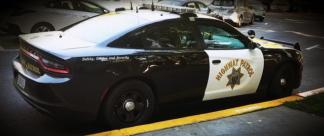 California Highway Patrol Dodge Charger in the yellow zone