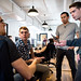 Air Force civilian software engineer, Grant Apodaca, 1st Lt. Justin Hohman, Engineering Practice lead, Senior Airman Tony Cruz, product manager and Capt.  Jacob Bleth, software engineer, discuss a software product at Kessel Run, a program within the Defense Innovation Unit Experimental, a United States Department of Defense organization, in Boston May. 30, 2018. Air Force software coders have been learning private sector techniques, such as coding in an open environment to encourage constant collaboration and communication, in order to deliver software solutions to the warfighter in weeks and months instead of years. (U.S. Air Force photo by J.M. Eddins Jr.)