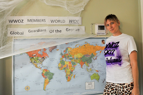 April Leigh in her airbrushed WWOZ shirt and the member map - 10.24.18. Photo by Michael E. McAndrew.
