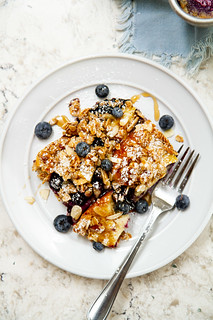 Blueberry Brioche French Toast Casserole -- Homemade brioche bread, fresh blueberries, and a crumbly oat streusel make this overnight breakfast casserole worthy of a morning meal any day of the week! @girlversusdough #girlversusdough | by girlversusdough