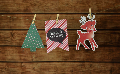 Christmas background with traditional decorations hanging on a rope | by wuestenigel