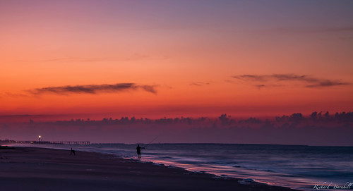 morning beach fishing clouds nature water landscape sky sunrise vacation ocean orange fisherman
