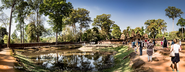 Multi-photo Panoramic View of a Reflection Pond inside the Outer Fence and Visitors Walking toward the Eastern Entrance to Banteay Srei Temple, Angkor, Cambodia-17a