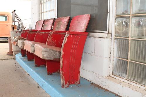 harmoncountyoklahoma hollisoklahoma red chair vintagegasstation ourdoor rural oklahoma smalltown historic vintage highway62 gasstationmemorabilia busycornersgasstation