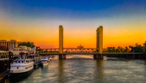 towerbridge sacramento sacramentoriver river water sunset sky orange boat boats outside california riverboat deltaking iphone illshootanything