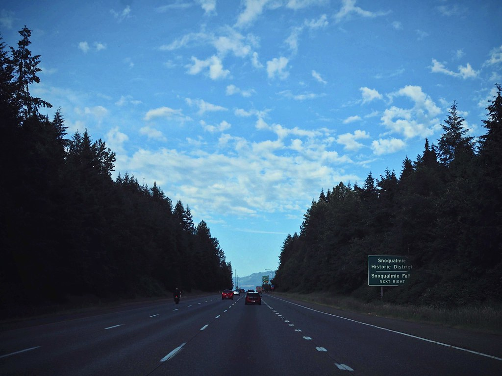 On the highway to Snoqualmie, blue skies and surrounded by trees