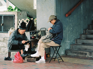 Shoe Mender   by Carl Hall Photography