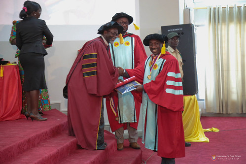 A PhD graduand being decorated