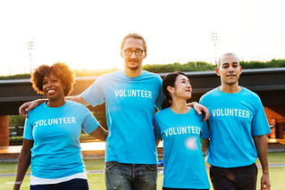 Group of happy and diverse volunteers | by Rawpixel Ltd