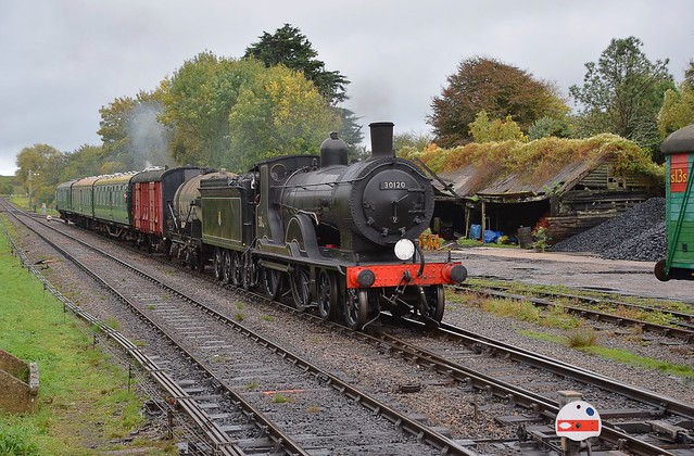 London & South Western Railway Locomotive, a Drummond T9 of 1899 as No.120, now No.30120 approaches Corfe Castle  with a mixed working from Swanage. Autumn Steam Gala. 15 10 2018
