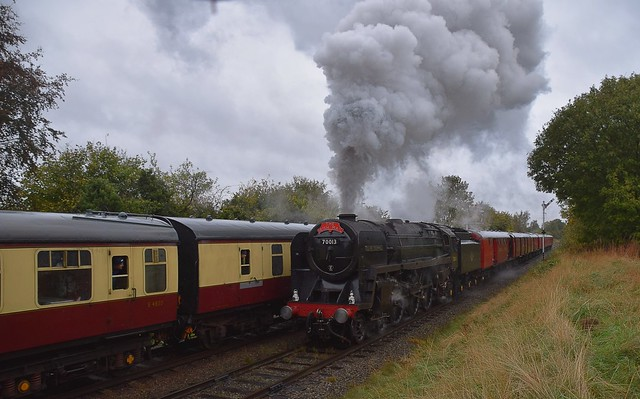 BR Standard Class 7, No.70013 'Oliver Cromwell' heads towards Leicester, with the Travelling Post Office Train and past No.92214, which is waiting to enter Loughborough. Autumn Steam Gala, Great Central Railway 06 10 2018