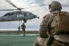 Sailors from EODMU-5 fast rope from an MH-60S Sea Hawk aboard the Royal Canadian Navy's MV Asterix, Nov. 1. (U.S. Navy/MC3 Erwin Jacob V. Miciano)