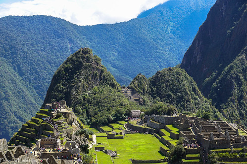 travel peru andes machupicchu huaynapicchu mountains mountainside mountain landscape nature sky ruins architecture building people cloud grass tree forest